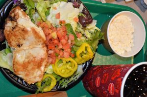The Grilled Chicken Greek Salad at Cosmic Ray's Starlight cafe is a great option for Health Eating in Disney World at Magic Kingdom!