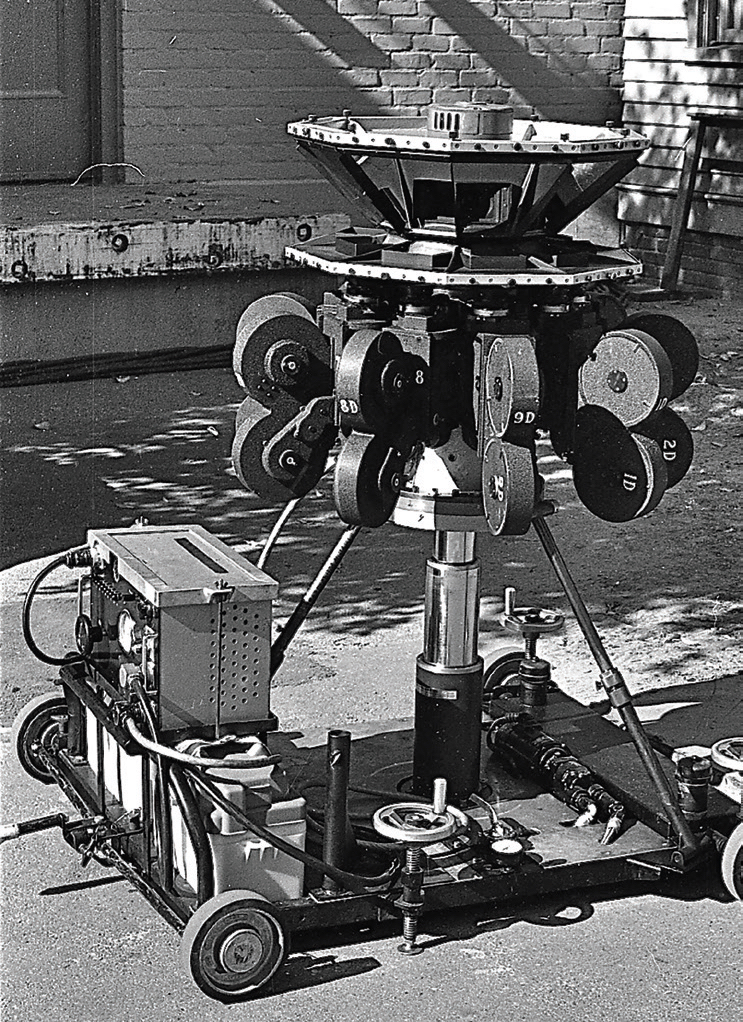 The updated 35mm Circle-Vision 360° camera mounted on a dolly with a hydraulic lift for moving shots. © Disney